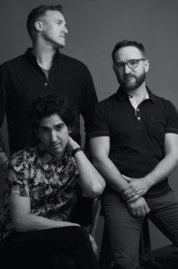 Sanctus Real is: Dustin Lolli (standing), Chris Rohman and Mark Graalman